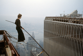 Philippe Petit walks between the Twin Towers